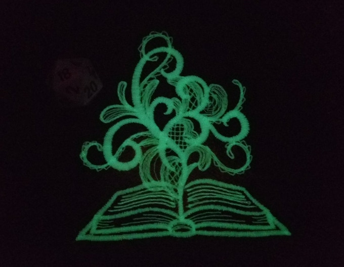 Spell book and smoke curls glow in the dark!