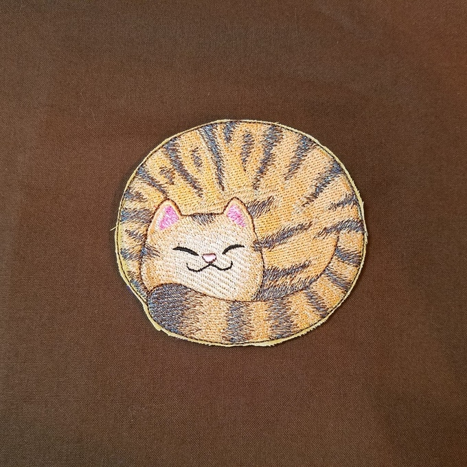 Frumpkin will be stitched on brown fabric with a blue lining--an homage to Caleb's eyes!