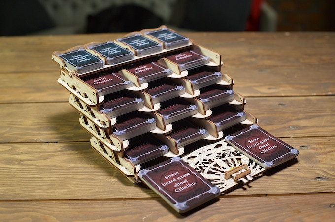 The Card Holder accommodates up to 500 game cards in 16 compartments with spacers