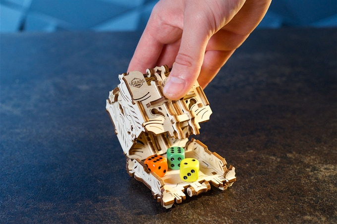 The Modular Dice Tower is comprised of a set of 4 individual dice cups that can either open completely or set ajar