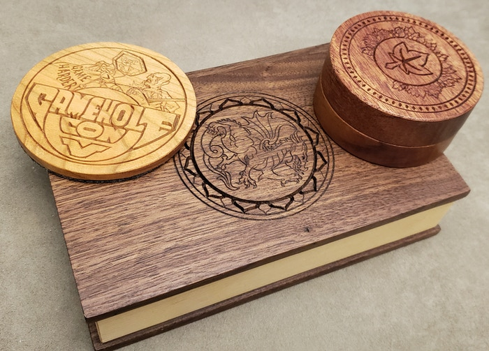 The coaster is Cherry, Tome is walnut and the Small Box is Mahogany.