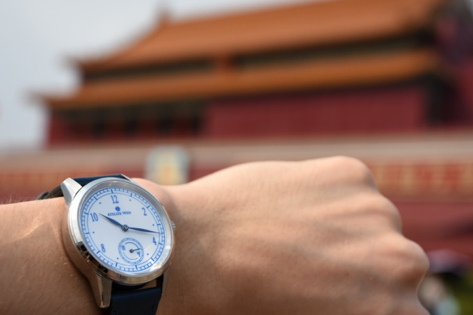 Hao's pure white contrasts against the Forbidden City's vivid red