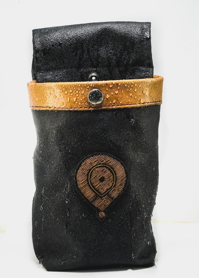 Luxury waxed canvas holster & non-slip textured bottle feel amazing in your hands.