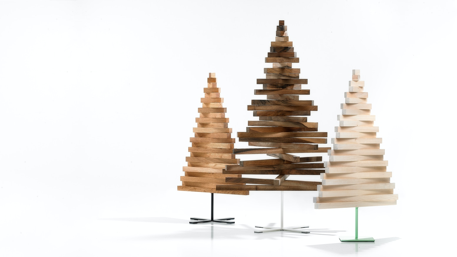 A sustainable, ecological, child & pet friendly designer tree made of wood for the holidays that packs up efficiently for safe storage.