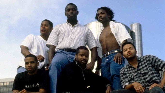Left to right in the back: Derrick May, Kevin Saunderson, Blake Baxter. Left to right in the foreground: Eddie Fowlkes, Juan Atkins, Santonio Echols