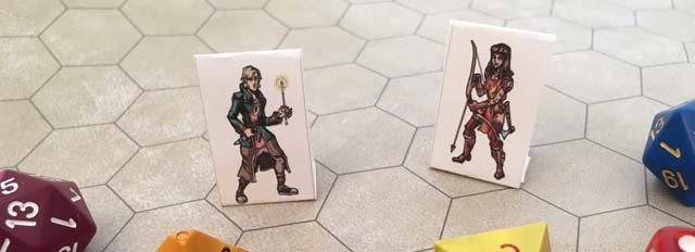 Mock-ups of paper miniatures. Back of miniature is a silouette of character.