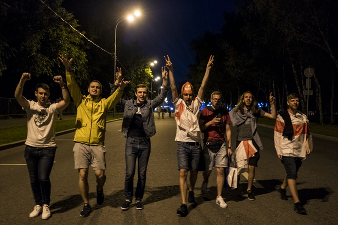 English and Russian fans party together in Moscow at the start of the tournament.