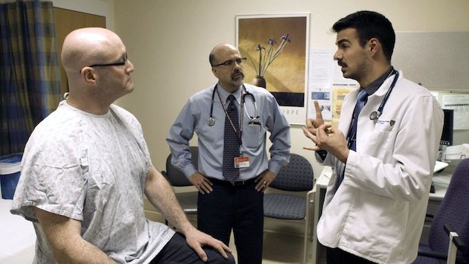Dr. Rafael Campo supervises a Harvard second year medical student during a clinical exam at Beth Israel Deaconess Medical Center.