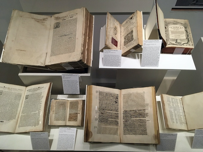 Condemned books hand-expurgated by Inquisitors, with blacked-out text & cut-out pages.