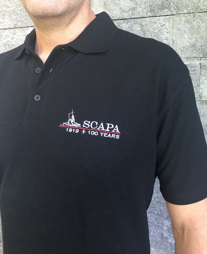 The Scapa Flow Polo (in blue, black, S,M,L,XL,XXL and Orkney-made). Also available with the Jutland / Skagerrak logo.