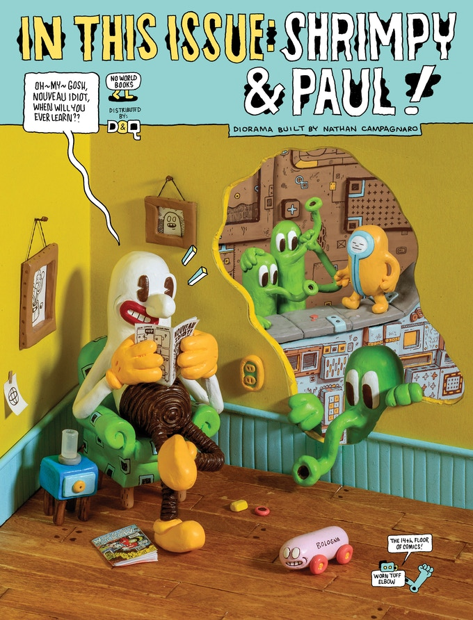 The back cover features a diorama created by Nathan Campagnaro