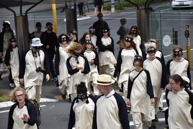 A Performance Walk Reverse Climate March – in full penguin attire – from Parliament into the community as part of Massey University's CCTA 2017 event, Wellington, New Zealand.