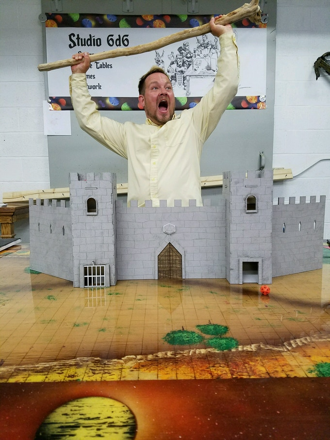 """Studio 6d6 founder Andy """"Cosmo Joe"""" Watkins who isn't an alien inhabiting an unassuming human's body just so that he can enjoy the thrill of creating and playing RPGs, going to cool conventions, and going on secret quests. Totally isn't that..."""
