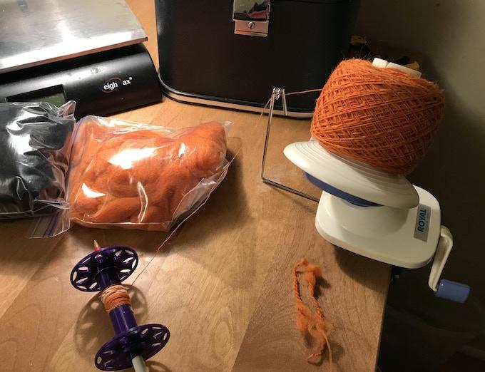 Putting a bobbin worth of yarn onto a ball winder