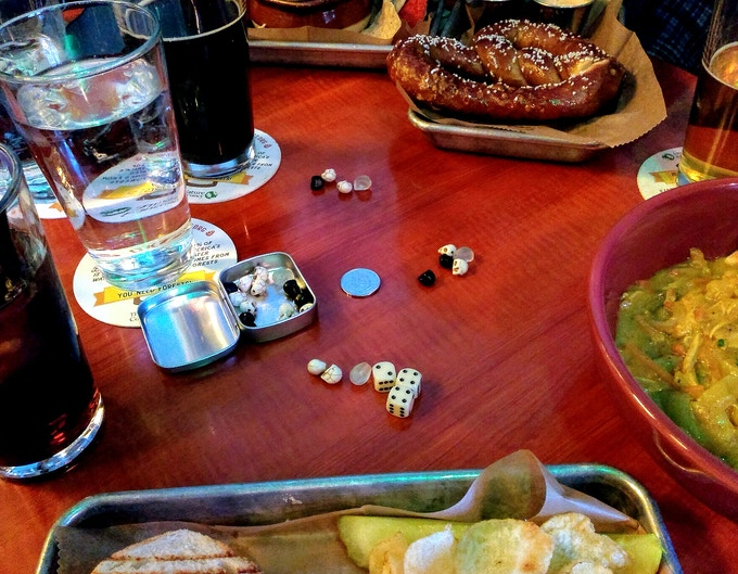 Plays in small space—easy setup—take out three dice & a crystal skull for each player