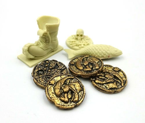 Coins, boot and plastic fish