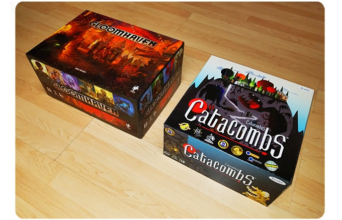 Gloomhaven box for size comparison. Prototype shown.