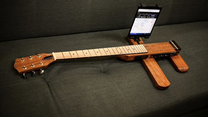 Hold your tablet/ portable speaker right on your guitar