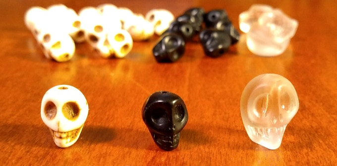 White & black skull are about 8mm and the crystal skulls about 12mm
