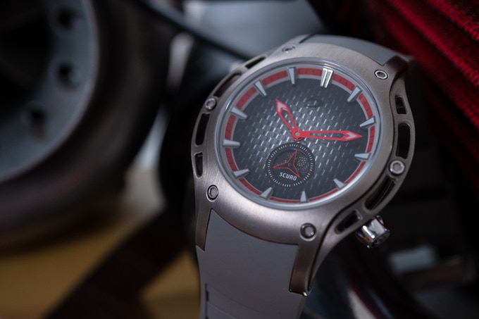 SV 1 - Brushed ti, red hands with optional grey rubber strap