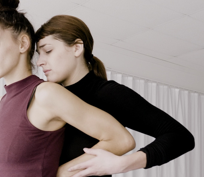 "Artists Kelly Hurlburt and Mathilde Gilhet in rehearsal for ""Red Patience"", Image is a still of footage by Doug Carraway"