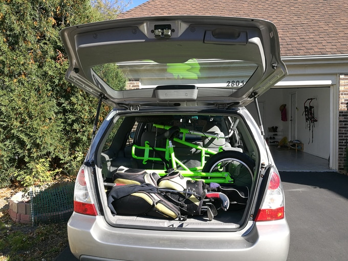 Loaded in  a small SUV with bag