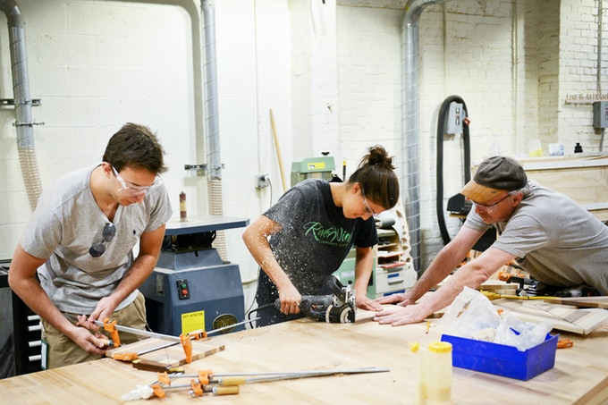 People working at NextFab's timber shop