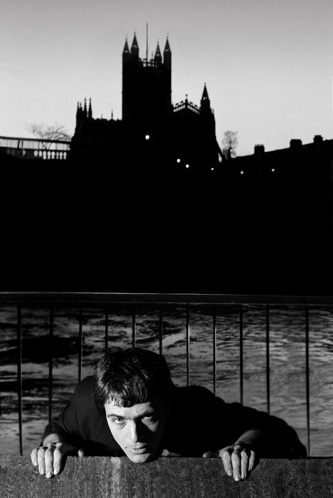 ©Clive Arrowsmith Peter Gabriel with Bath Abbey Background
