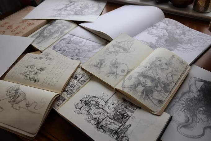 Photo of some of the many sketchbooks.