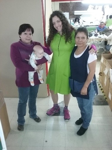 Angelina holding Rivers (my third son), me, and Nena.
