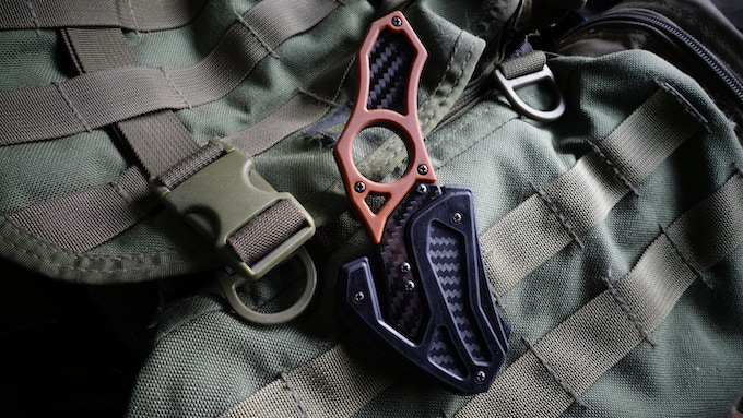 The Praetor sheath is able to clip onto MOLLE webbing for easy backpack attachment