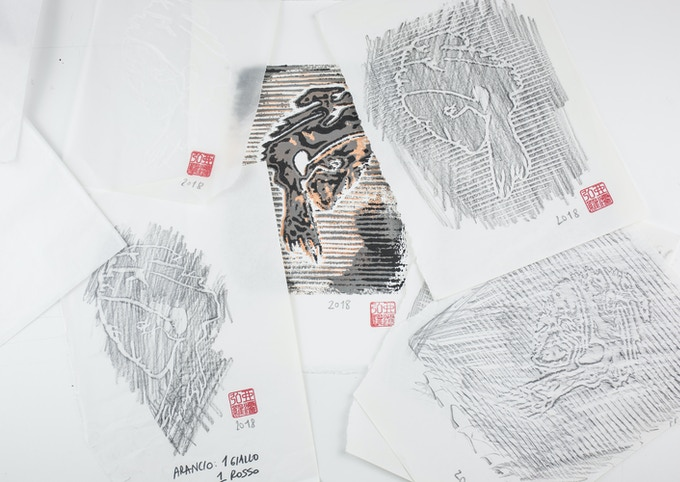 Sketches surrounding a xylographic print