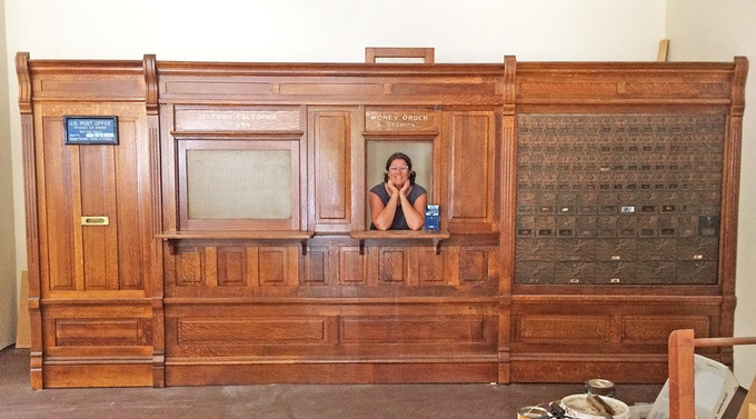 Lea visiting the antique post office counter that she found on craigslist in Drytown, CA. Score!