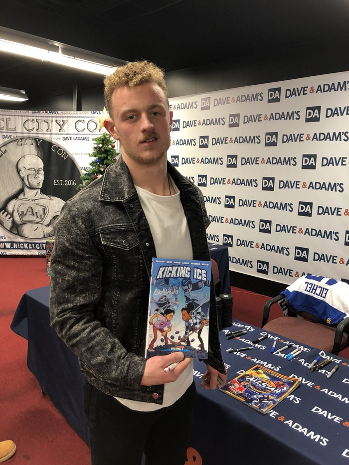 Jack Eichel with a copy of Kicking Ice