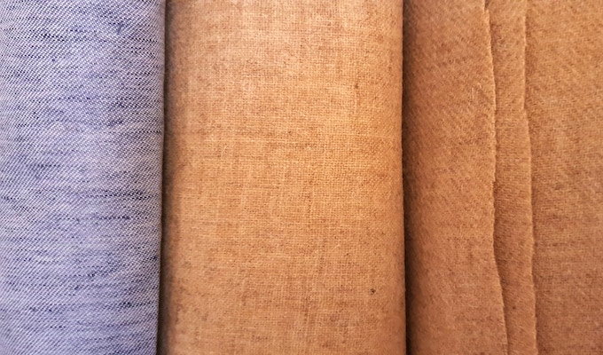 A sample of our exquisite fabrics, which are used in the Royal Needle collection. Left to right: linen (melange or plain), 1-1 plain weave wool, 2-2 twill wool