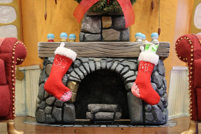 Tiny stockings hang on a miniature mantle, waiting for Santa to appear.