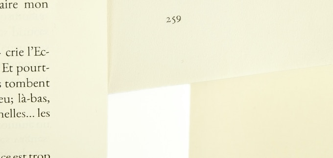 The text paper of our scrolls may look different in different photos due to lighting conditions and other factors. Here's a color comparison under standard D50 light. Clockwise from left: one of our scrolls, a slightly darker ivory-white text paper, a true ivory stationary paper, and a brilliant white bond (like copy paper). The first two are both typical of modern hardcovers.