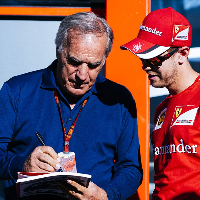 "Giorgio doing an autograph to four-time World Champion"" Sebastian Vettel"