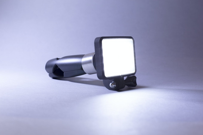 Glowstone flashlight can also be used as a traditional flashlight with its transforming tripod grip handle