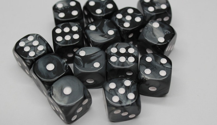 PMG comes with 6 black dice and 6 white dice
