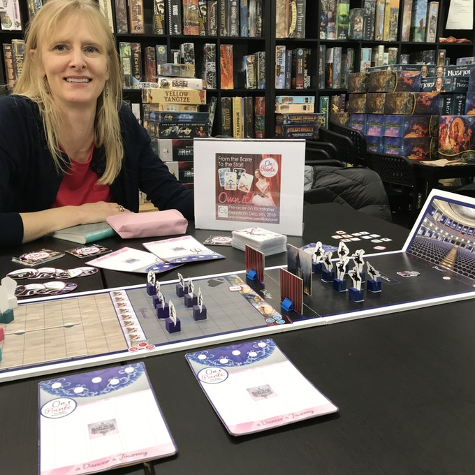 Elisa play-testing the On Pointe prototype at Board Game Bliss