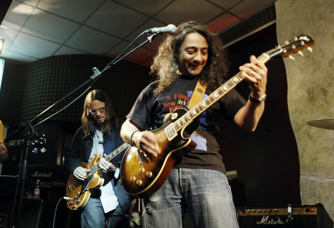 "Max Arrigo on stage with Luther Dickinson back in the 2011 jammin' on the Free tune ""Ride a Pony"""
