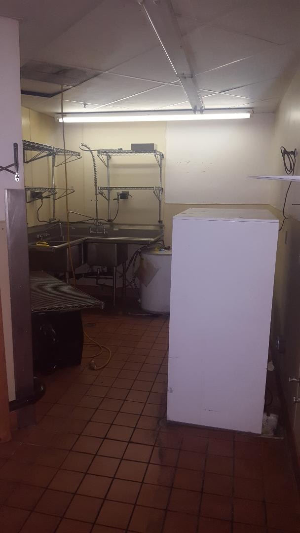 The second dish clean area. The white case is a double sided reach thru refrigerator case. No clue if it is functional. Note another extension cord hanging from ceiling.