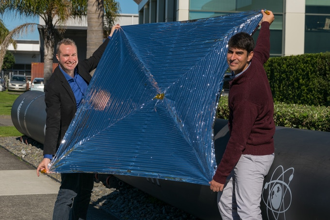 The NABEO team with the unfolded sail at the Rocket Lab facility in Auckland, NZ