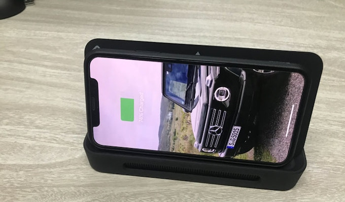 Wireless charger with phone holder