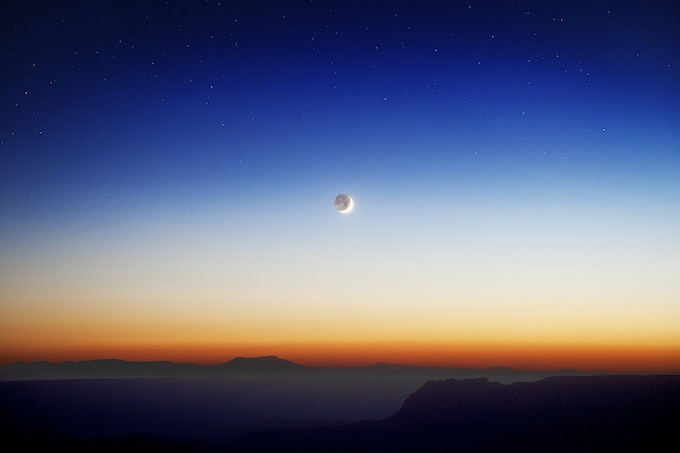Moon rising over the Grand Canyon