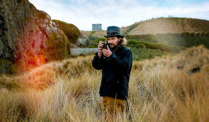 Jason Momoa with his Leica camera working behind the scenes on an epic battle for Frontier Season III
