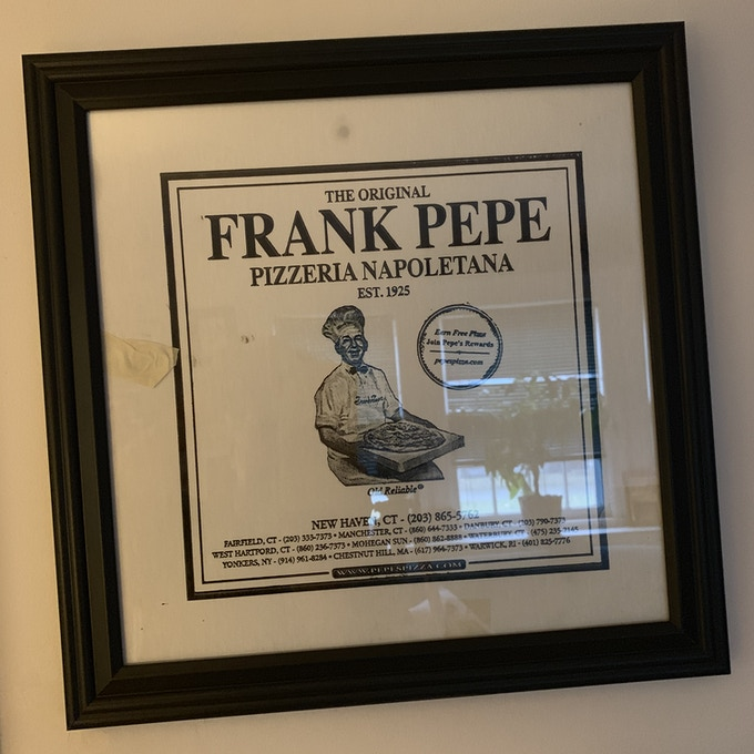 The framed Pepe's pizza box, as seen in the film.