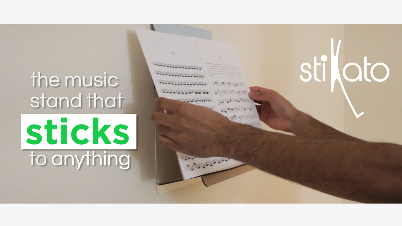 The world's first music stand that sticks to any surface & supports an entire binder of music.