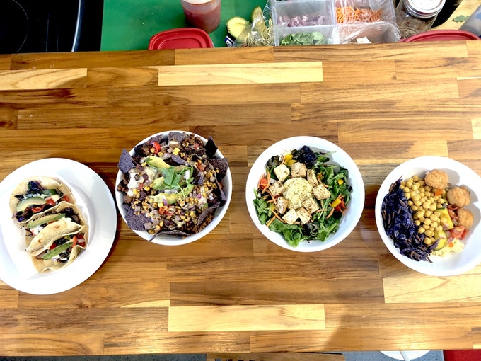Left to Right; Veggie Tacos, Beef Nachos, Mixed Green Tofu and Quinoa Salad, Spice Bowl.